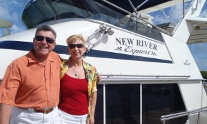 Photo of happy customers in front of boat.