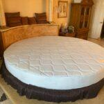 Custom Zeno mattress round in a luxurius home master bedroom.